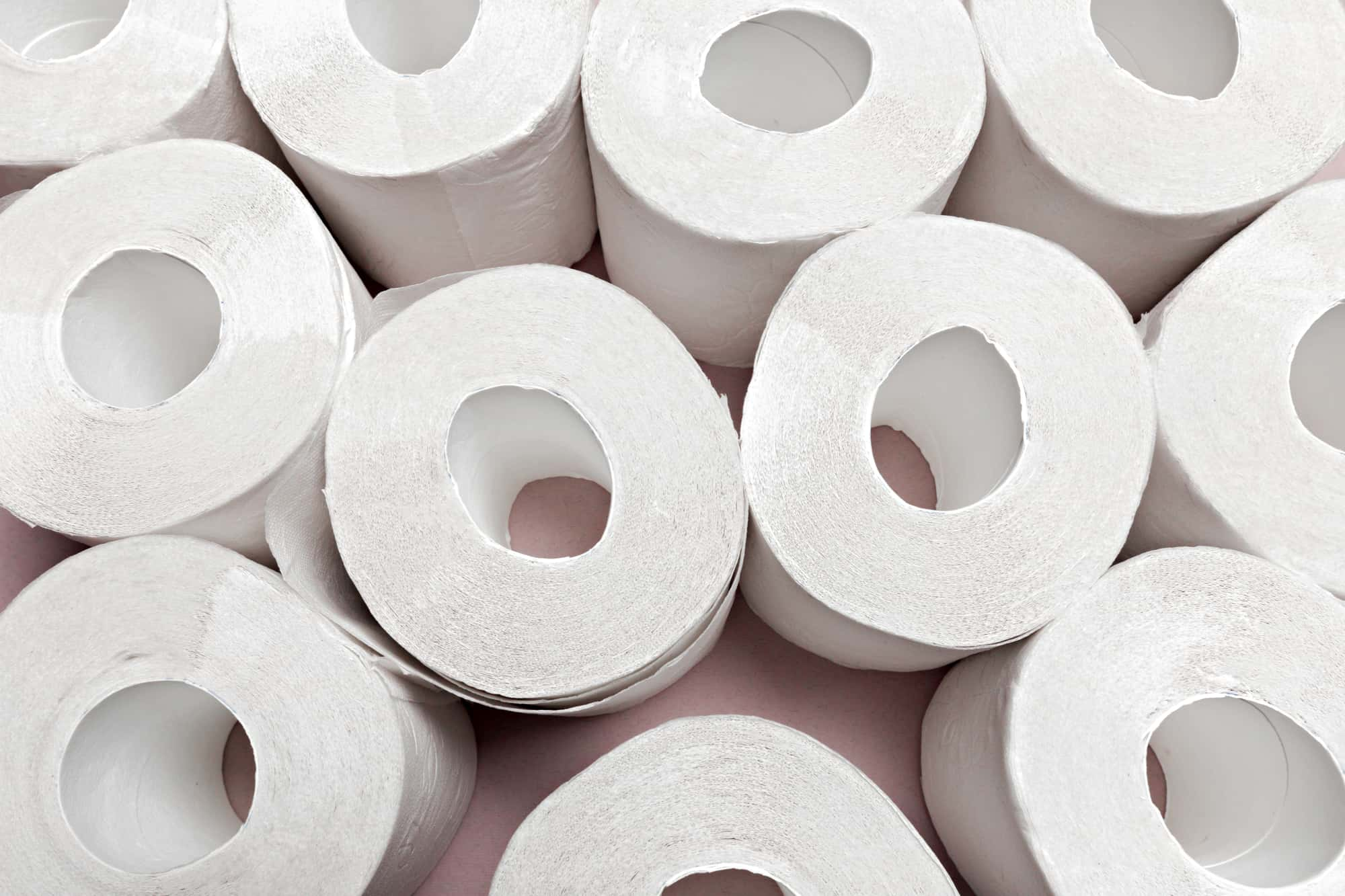 Toilet paper on pink background