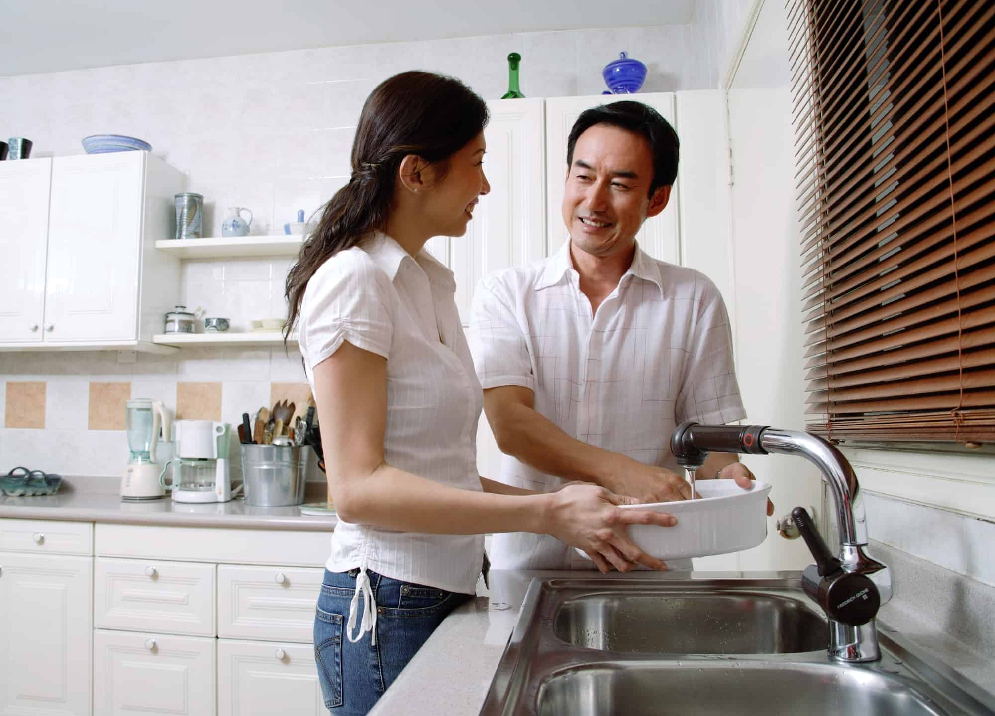 Asian couple doing the dishes using non-toxic dish soap