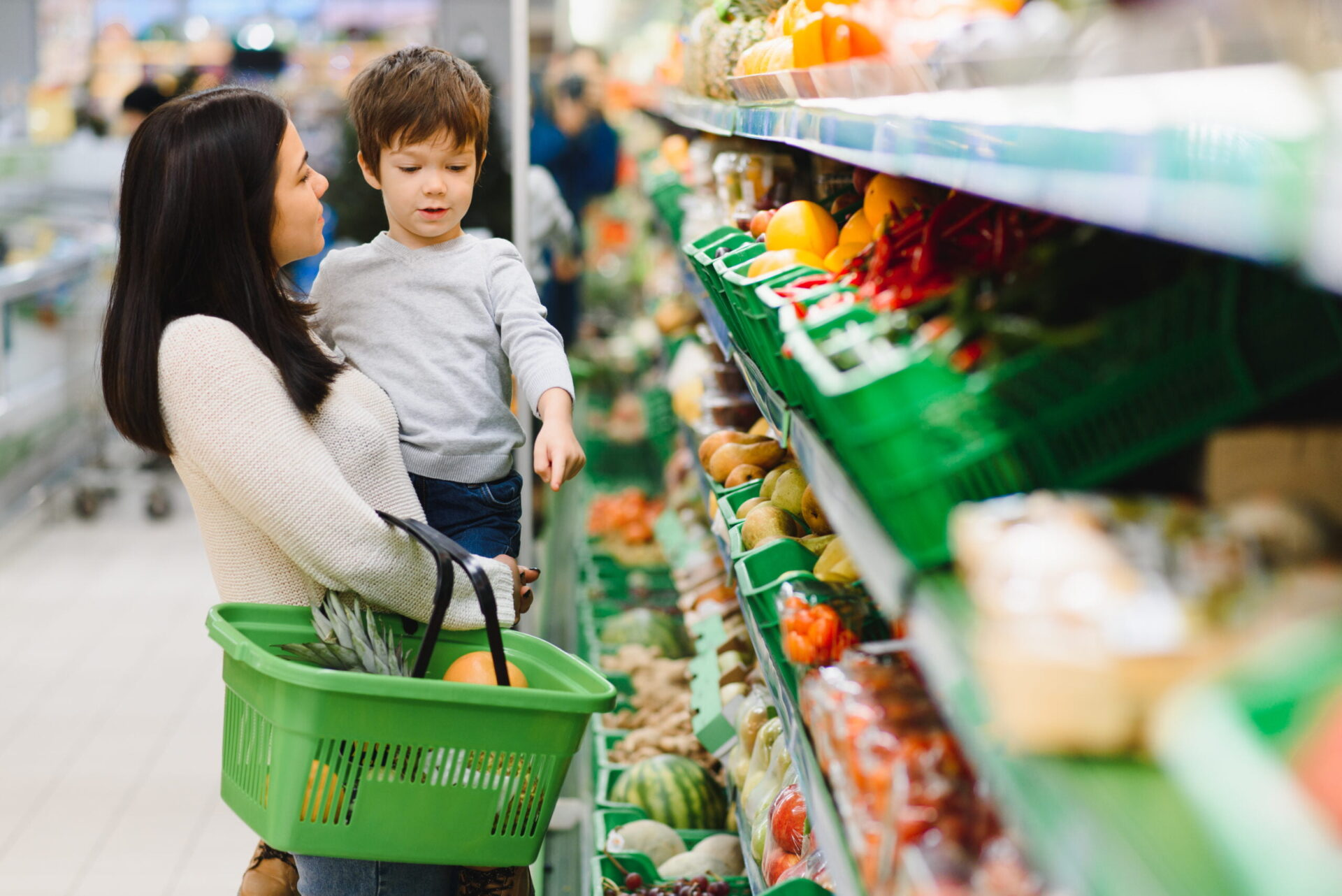Mother with son at a grocery store