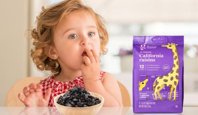 Child eating good and gather raisins from target