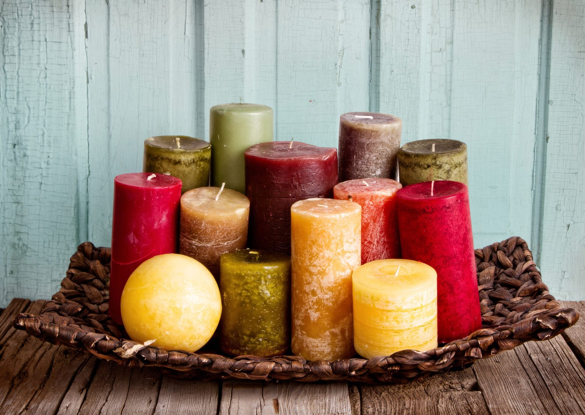 collection of decoratice candles on a rustic antique wooden