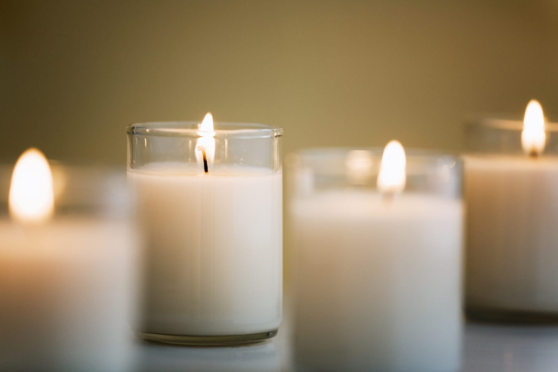 white Candles in glass voltive