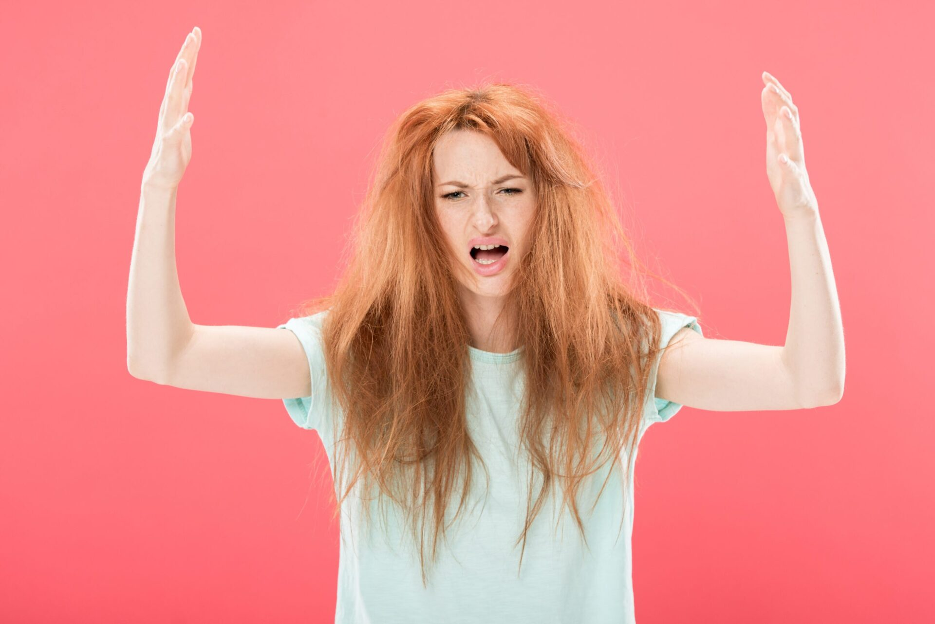 redhead frustrated about her oily hair that needs dry shampoo