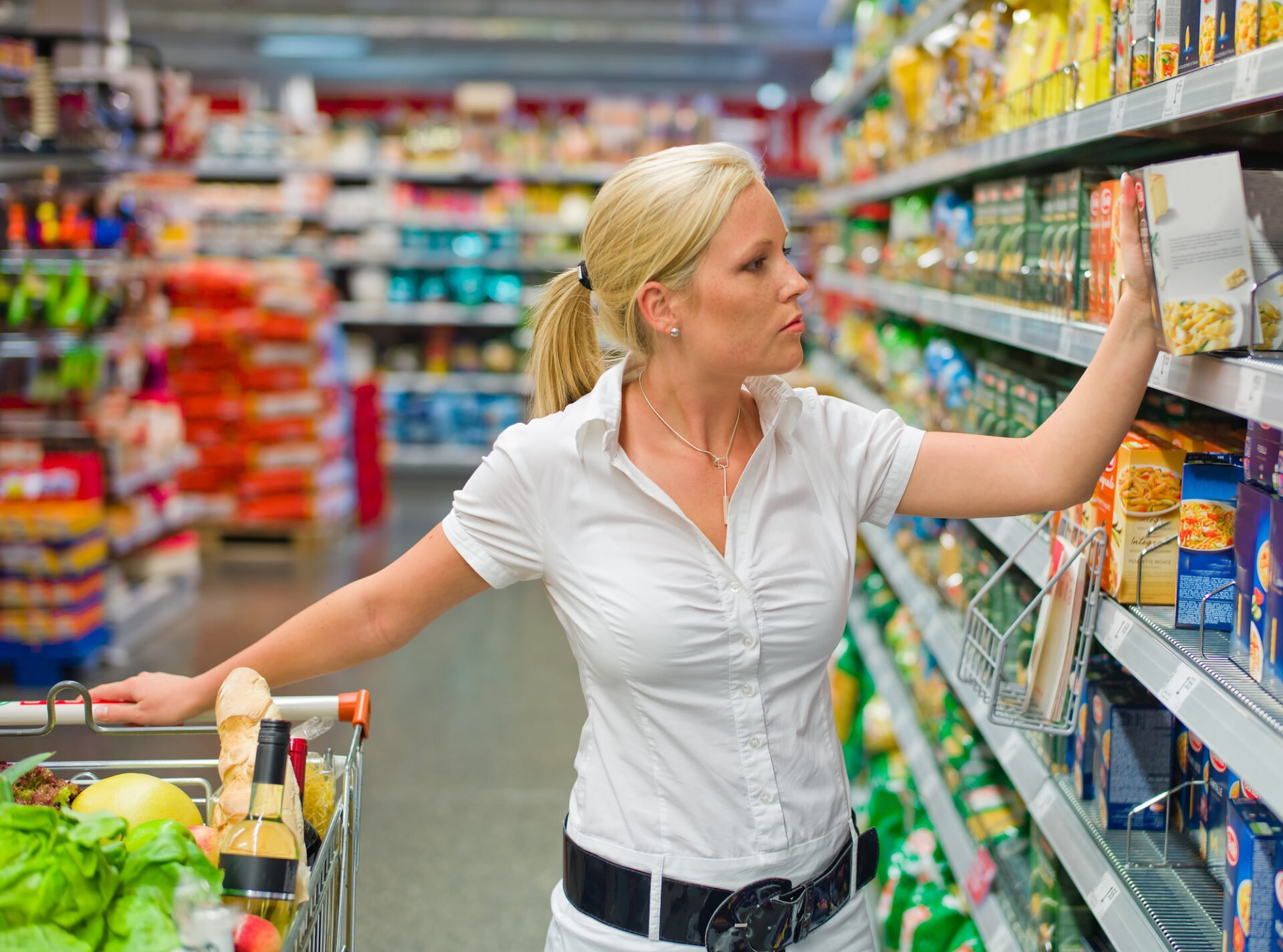 a woman when buying food in a supermarket. everyday life of a housewife