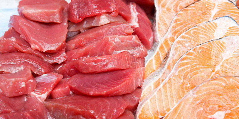 Bunch of fresh tuna steaks and salmon cutlets