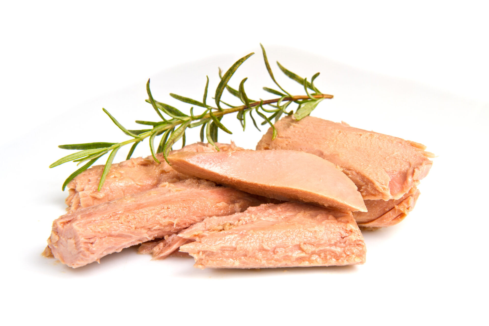 tuna fish isolated on white background with twig of rosemary