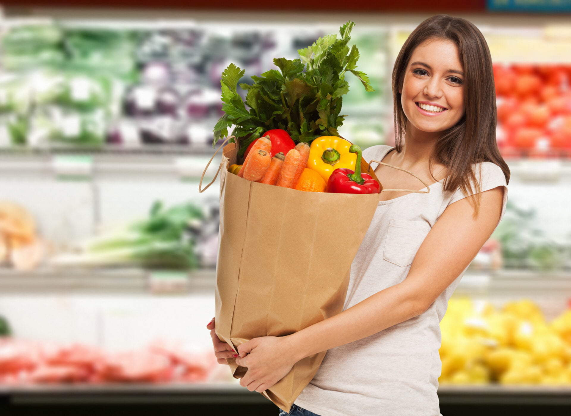 latino woman shopping at grocery store