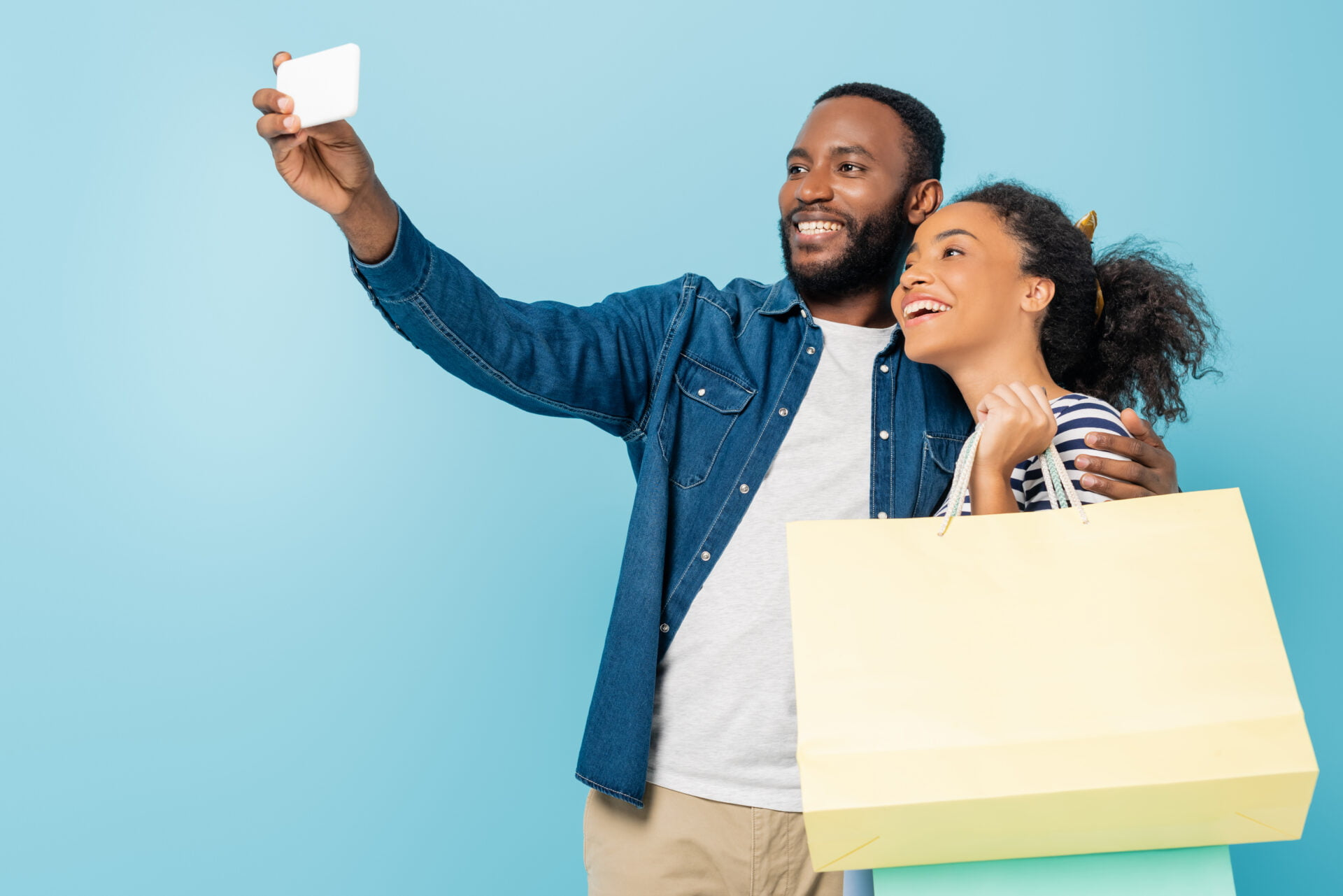 black man and woman shopping and taking selfie