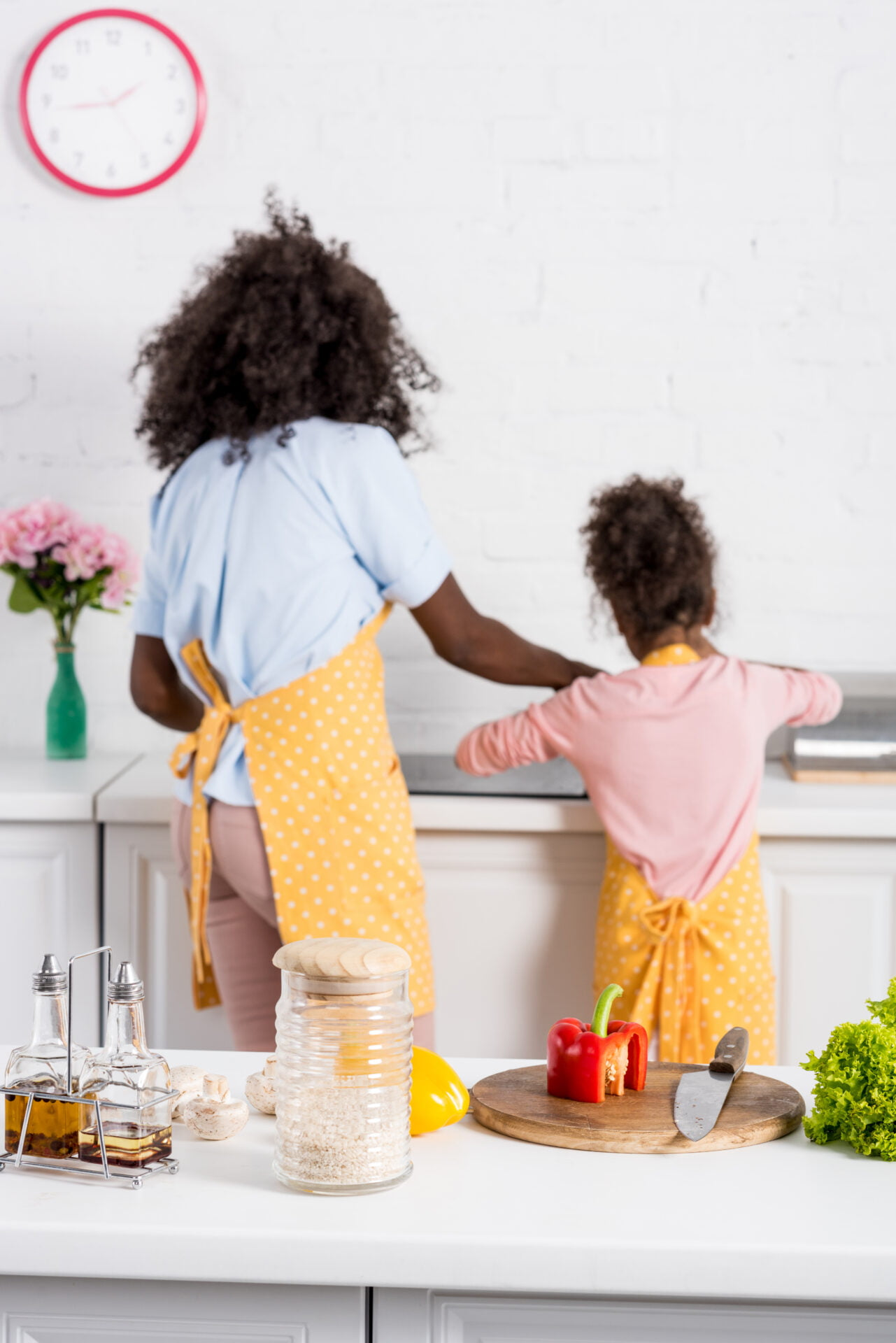Black mother and daughter baking in the kitchen