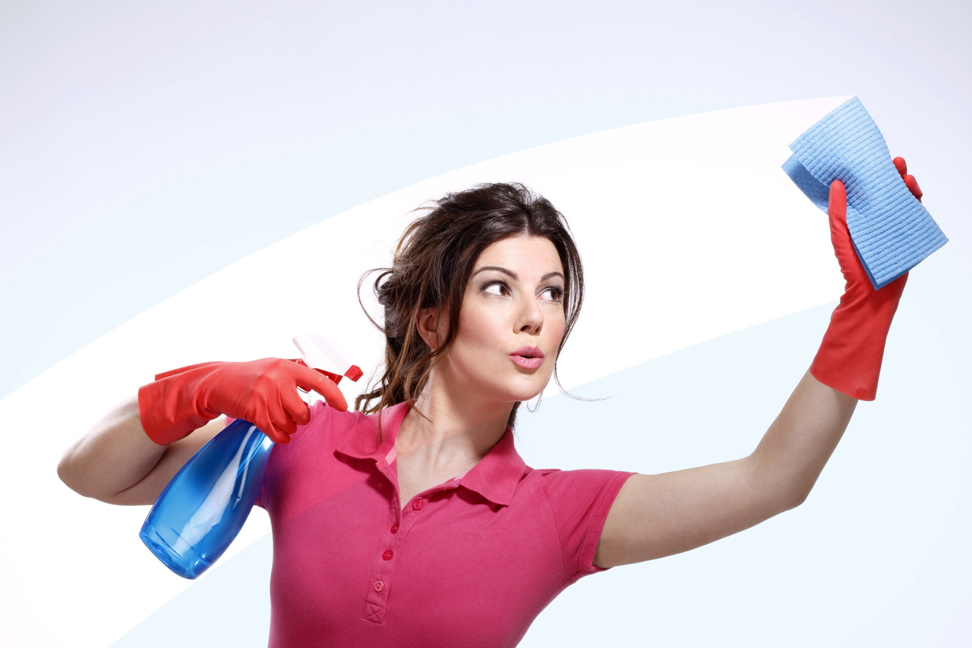 young housewife cleaning with natural cleaners