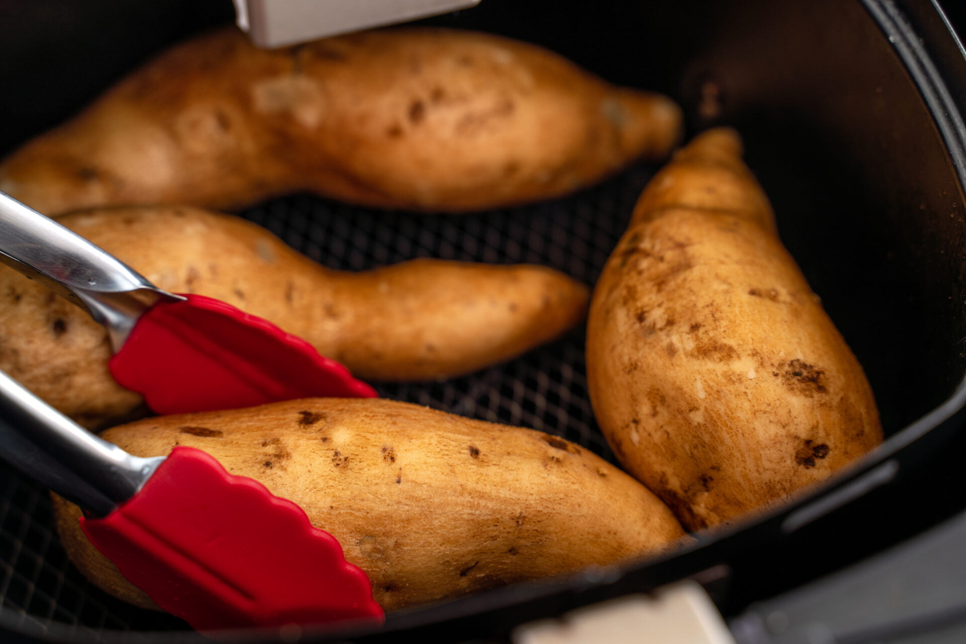 Roasted sweet potato cooked by airfryer at home. Healthy food for diet eating