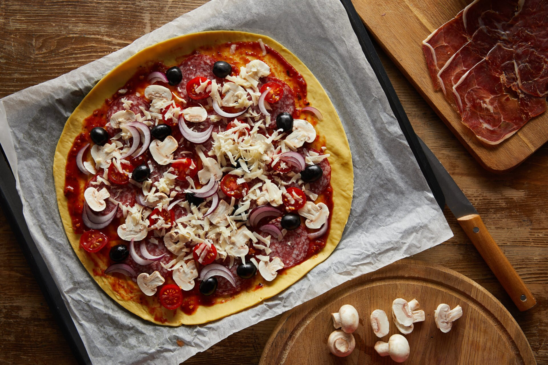 homemade pizza on parchment paper