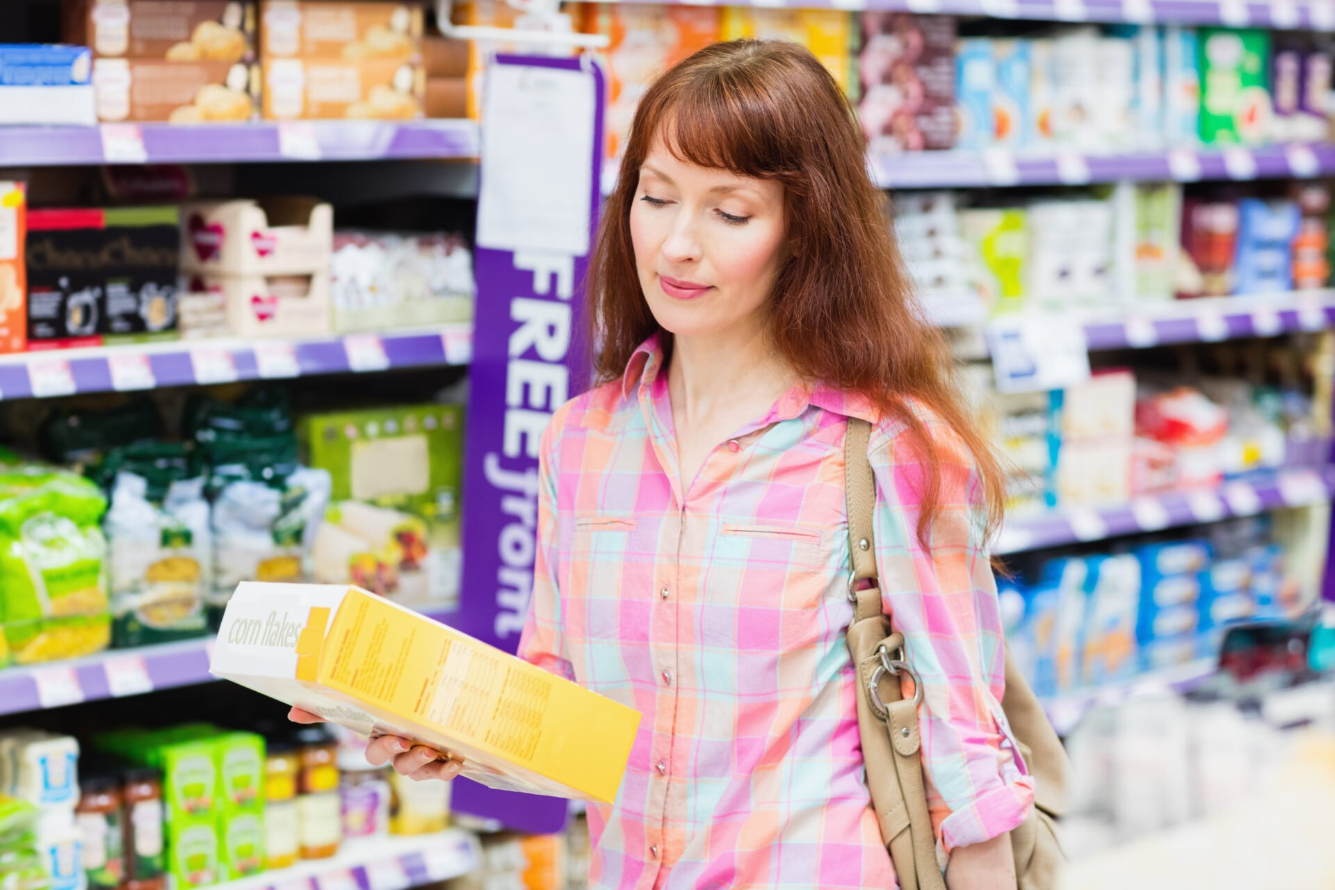 Thoughtful woman choosing a product at supermarket