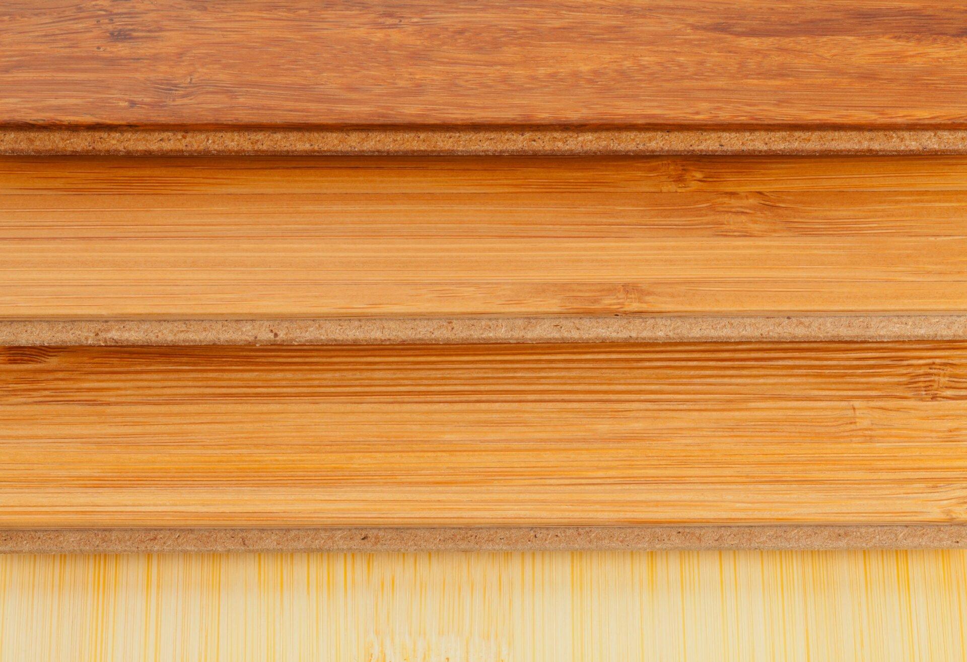 Stack of bamboo laminate flooring samples close up