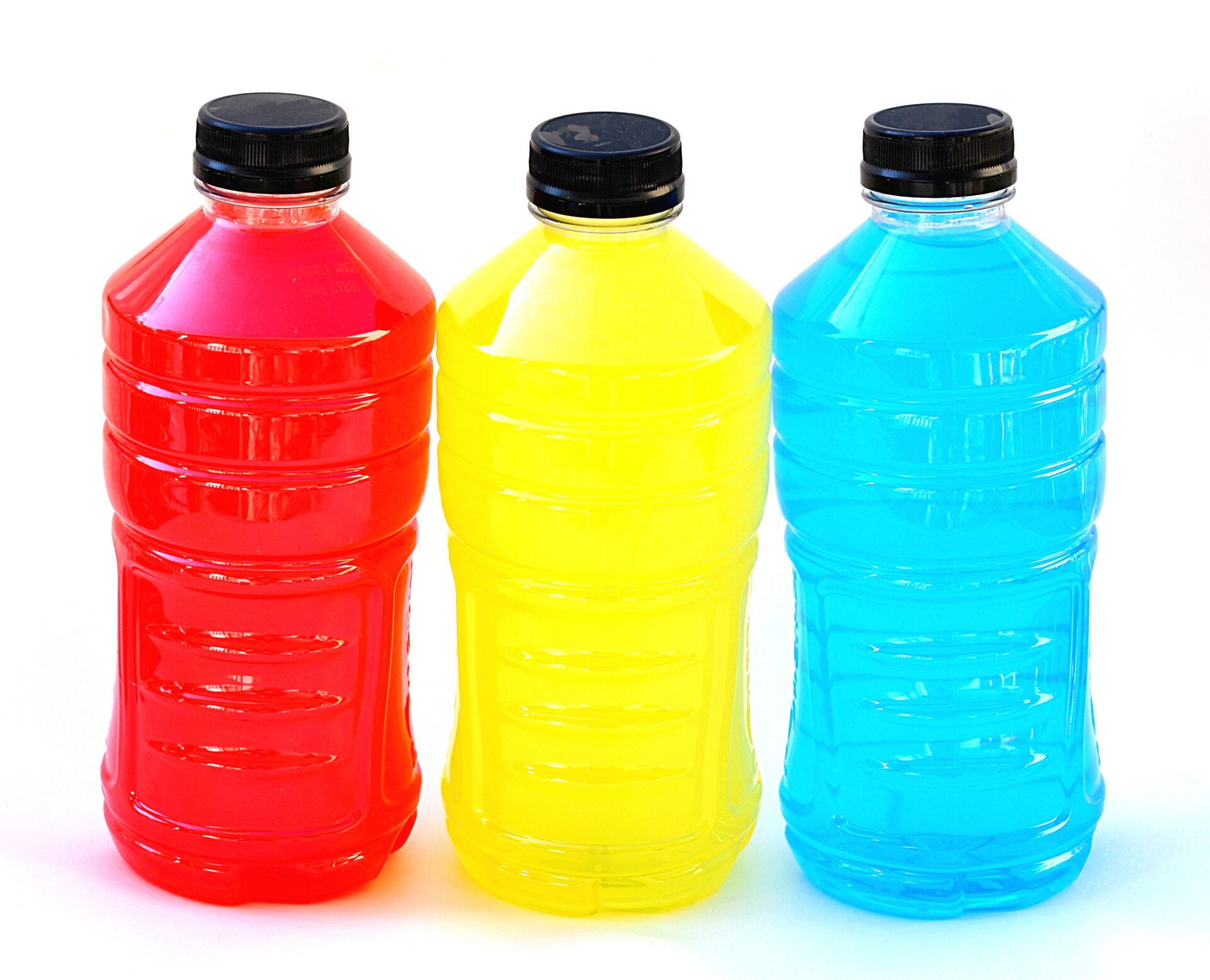 electrolyte replacement drinks in red, yellow & blue