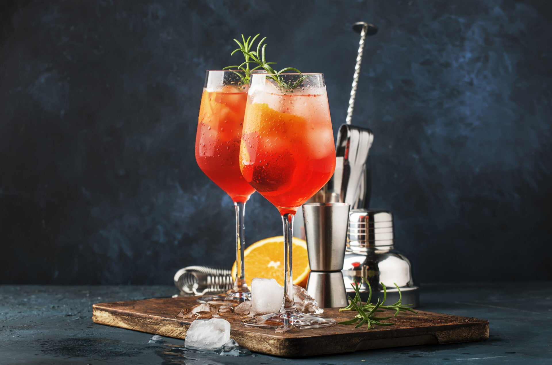 Milano spritzer alcoholic cocktail with red bitter, dry white wine, soda, zest and ice