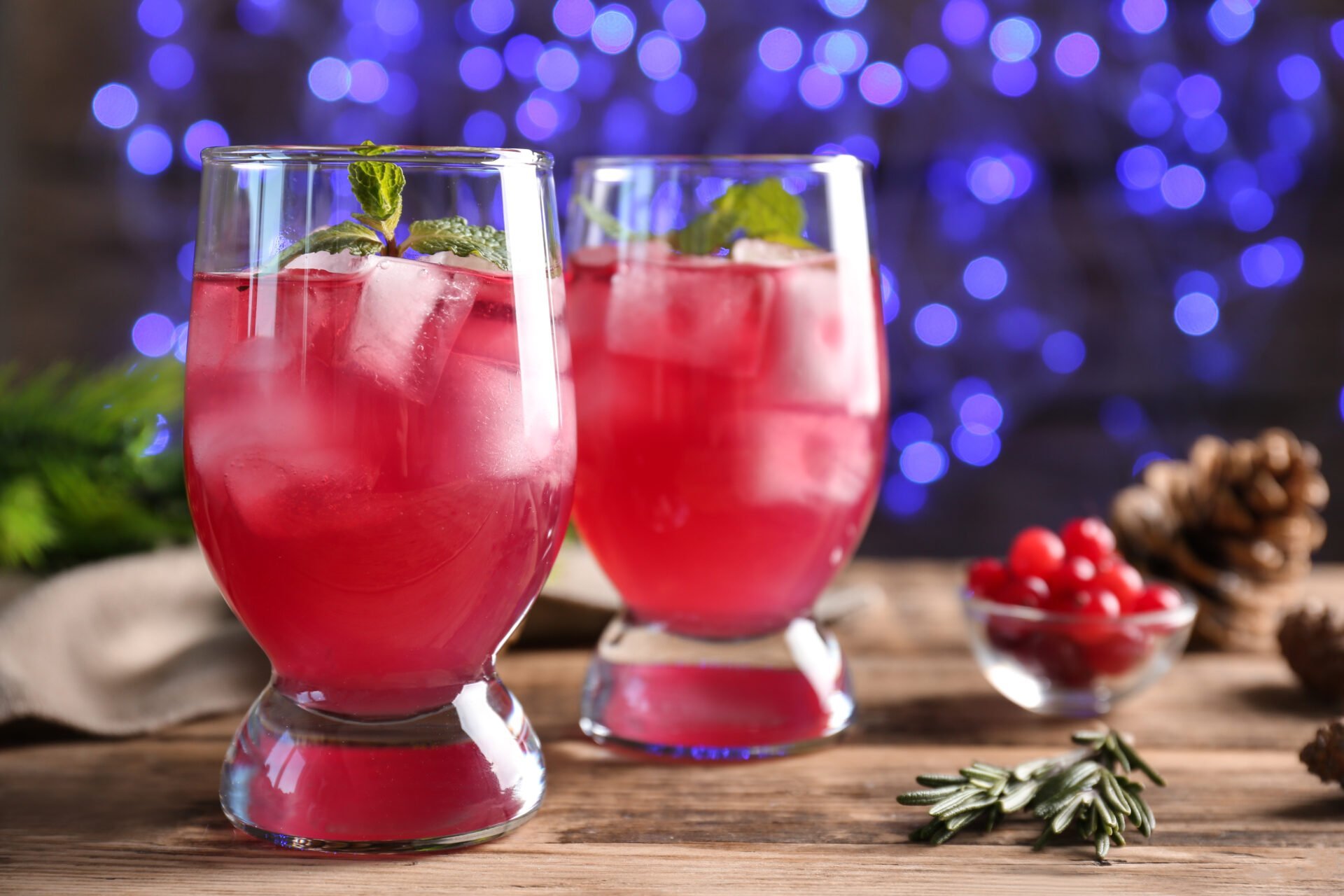 Glasses of delicious wine spritzer on blurred lights