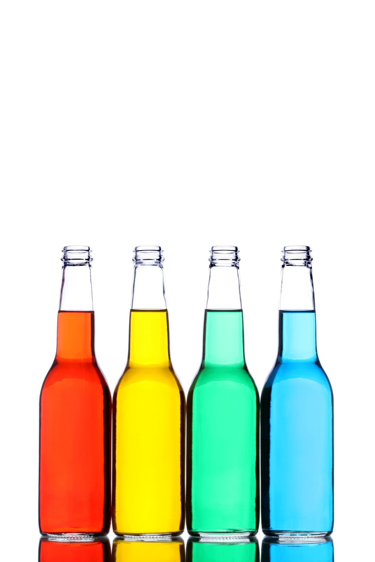 glass bottles with reflection and different colored liquids