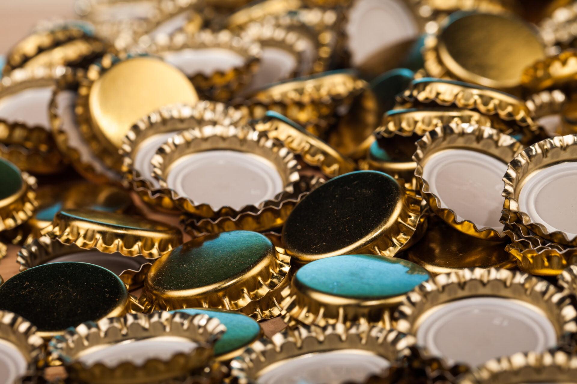 golden bottle caps on table