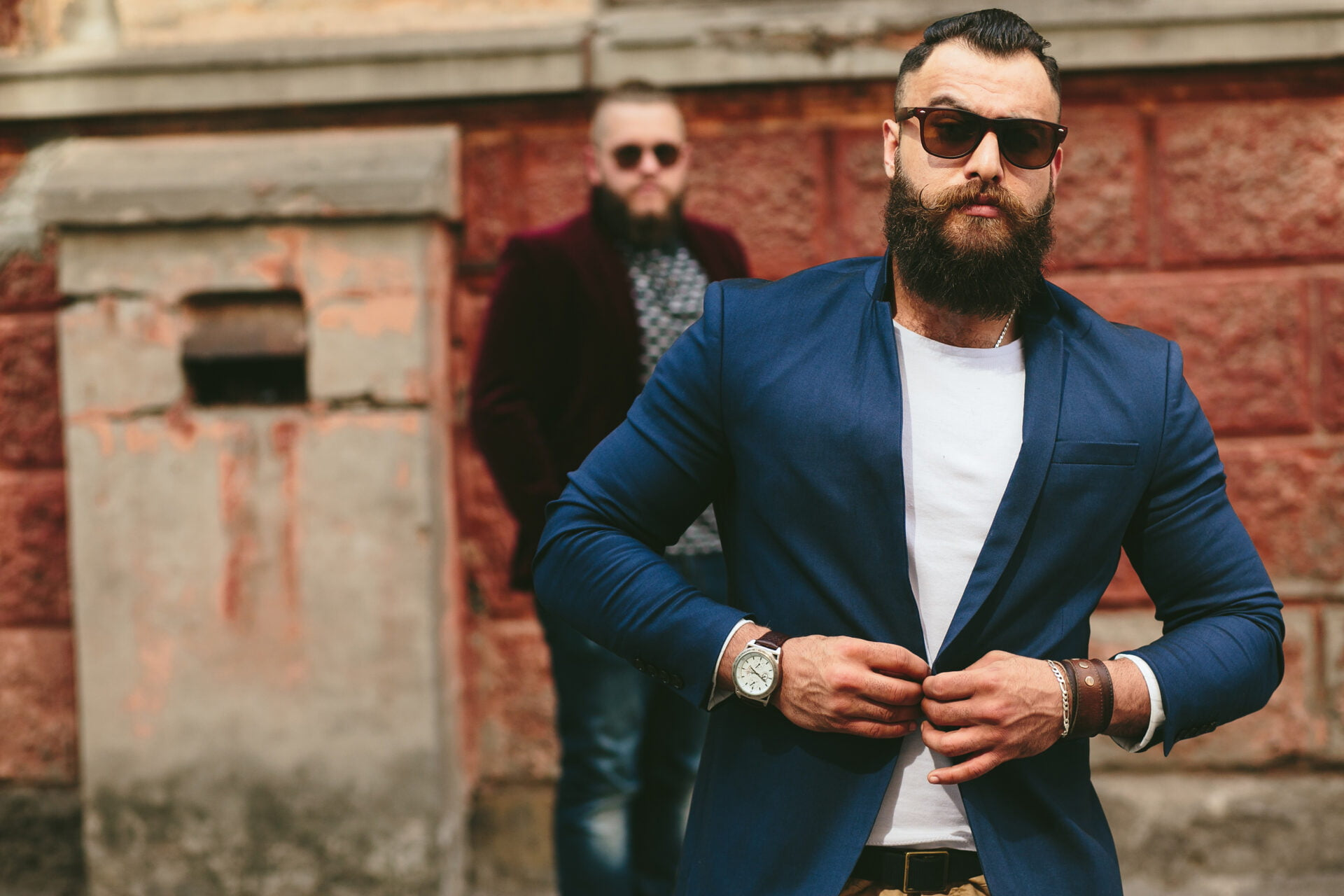 Two stylish bearded men on the background of the old town
